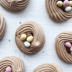 Swirls of chocolate meringues topped with mini eggs to look like birds nests